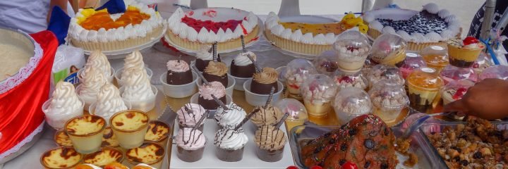 Desserts sold at a market stand, Peru